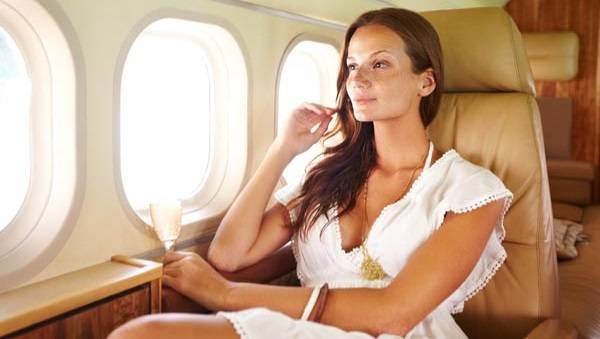 business-woman-on-airplane