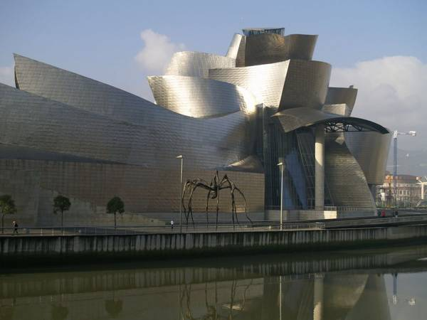 ivivu-admire-frank-gehrys-twisting-undulating-architecture-at-the-guggenheim-museum-in-bilbao-spain
