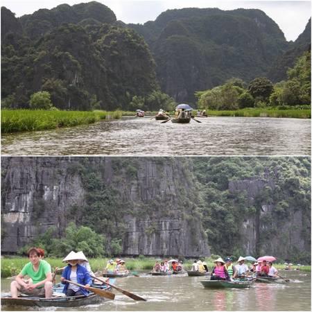 Du khách trên thuyền thăm Tam Cốc
