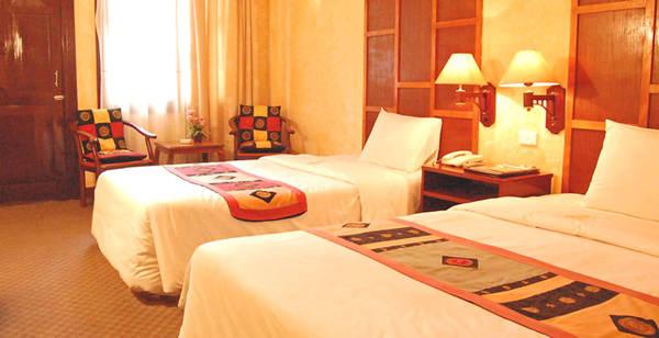 Phòng nghỉ ấm áp tại khách sạn Grand View Sa Pa.