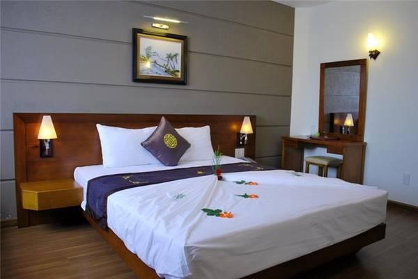Phòng nghỉ tại khách Sạn Barcelona.