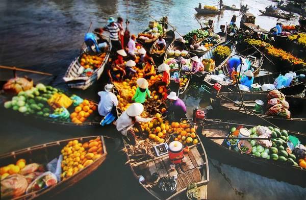 Chợ nổi Cái Răng là một trong những điểm tham quan đặc sắc nhất ở Cần Thơ. Ảnh: tourstohoian.com