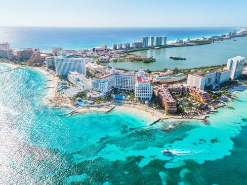 Nên mang gì khi đến Cancun?  Đến Cancun (Mexico) hay bất kỳ khu nghỉ dưỡng nào ở Caribbean, bạn đừng bỏ qua áo tắm cùng một số món đồ đơn giản như mũ cói cỡ lớn, áo choàng nhẹ và kem chống nắng.