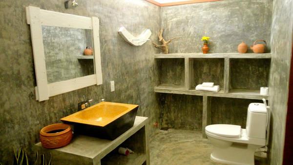 Phòng vệ sinh được sơn tường xi măng lạ mắt với những thiết bị hiện đại, tiện nghi