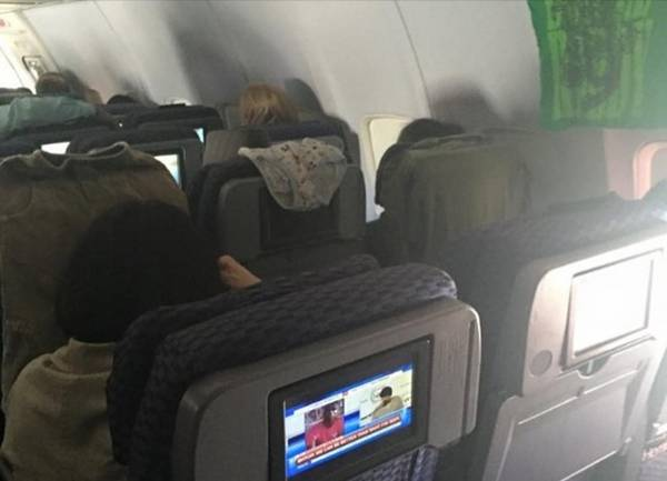 Aircraft seats are not places to hang.  Photo: Business Insider.
