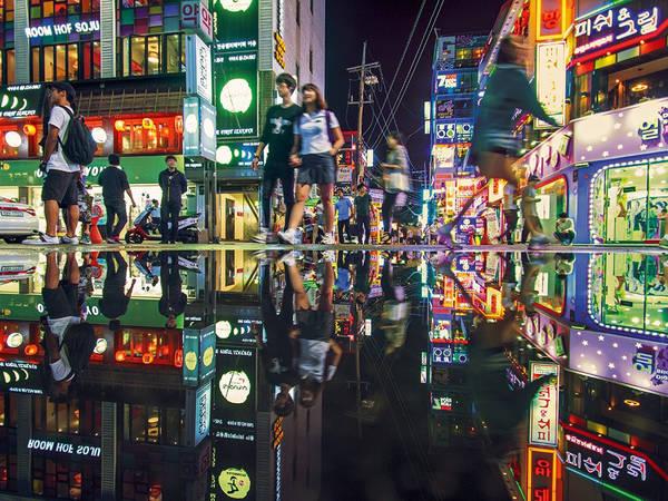 9. Chơi kiểu Gangnam: Sau cơn sốt của bài hát Gangnam Style (Psy), khu Gangnam sang chảnh đã trở thành địa điểm thu hút khách du lịch mới của Hàn Quốc. Ảnh: GettyImage.