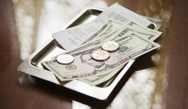 Tray with receipt and cash --- Image by © John Smith/Corbis