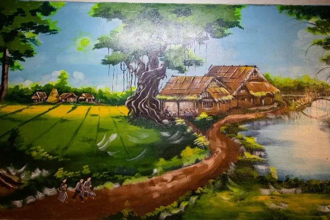 Bức phù điêu đặt trong gian võ ca tái hiện khung cảnh lớp học xưa tại đình Chí Hoà với nhà vách ván, cây đa và bến nước.